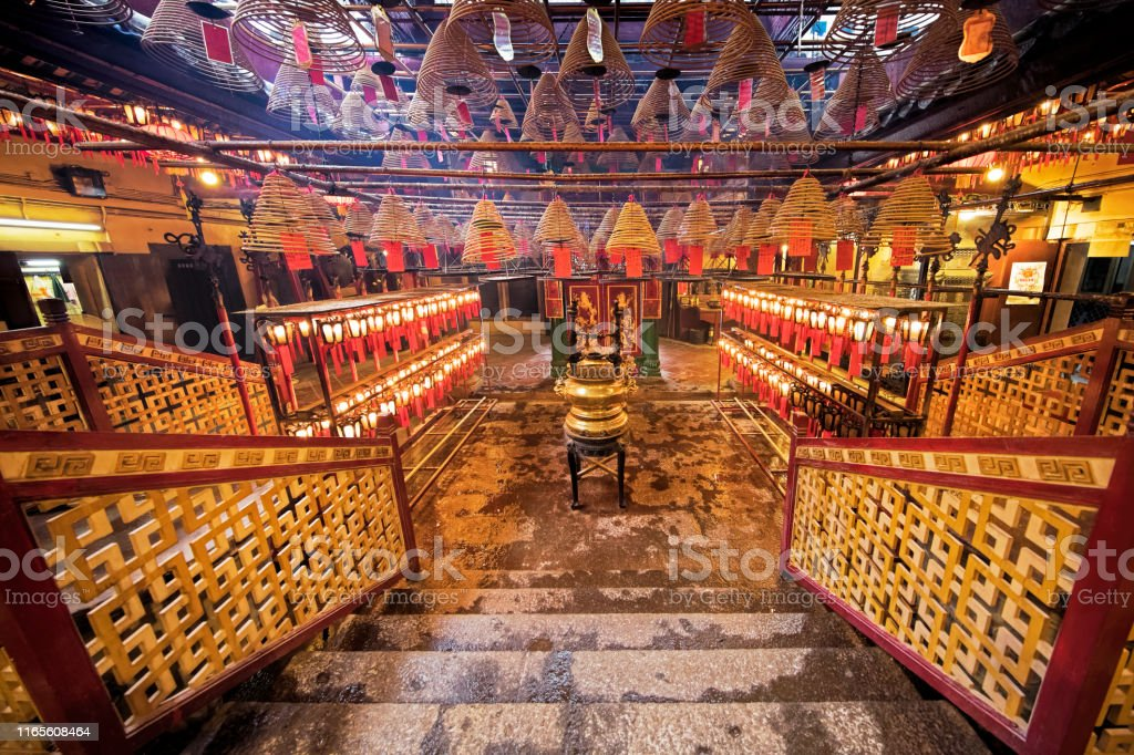 Man Mo Temple, the famous Taoist temple in Hong Kong Incense burning in the Man Mo Temple, the most famous Taoist temple in Hong Kong China Asia Stock Photo