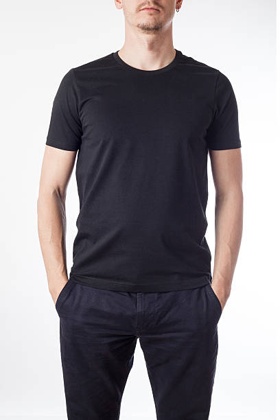 Man modeling a black t-shirt ready for graphic design stock photo