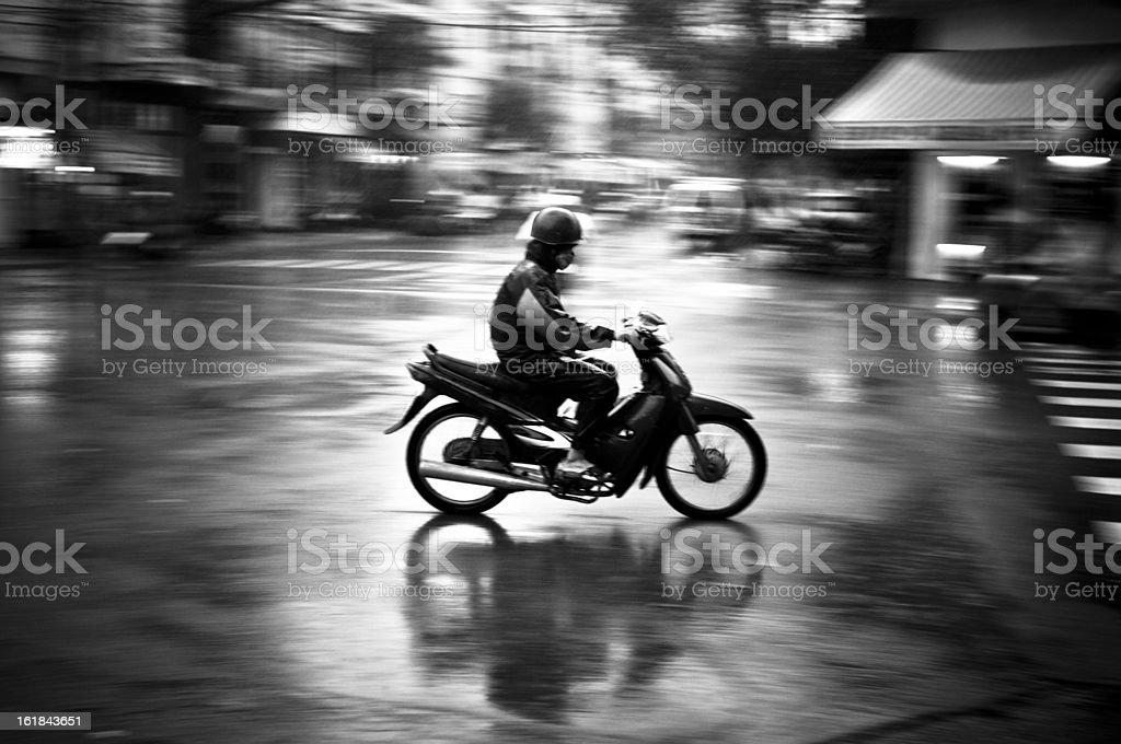 Man Motorcycling In The Rain In Nha Trang, Vietnam stock photo
