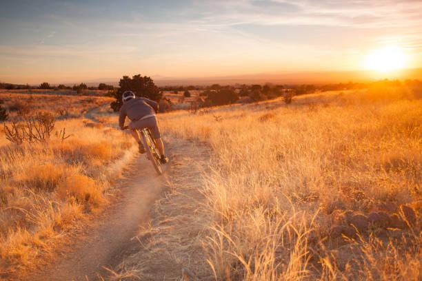 man mountain biking stock photo