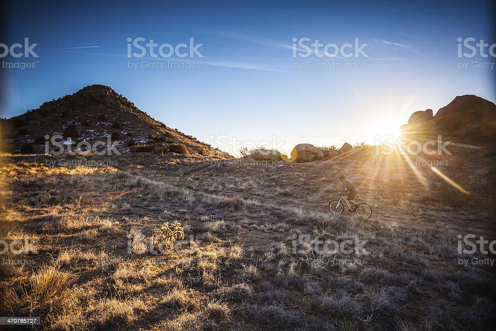 man mountain biking sunshine landscape royalty-free stock photo