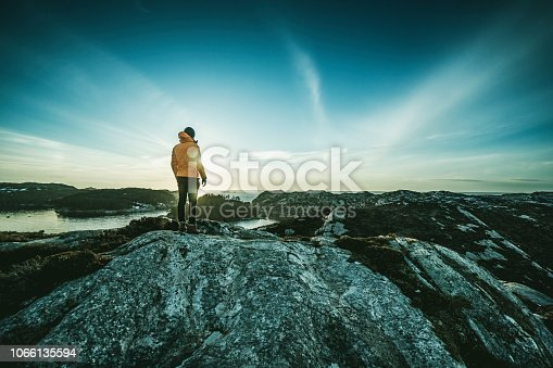 Man mountain hiking by a fjord in Norway