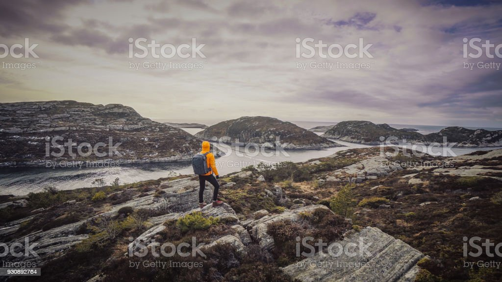 Man mountain hiking by a fjord in Norway stock photo