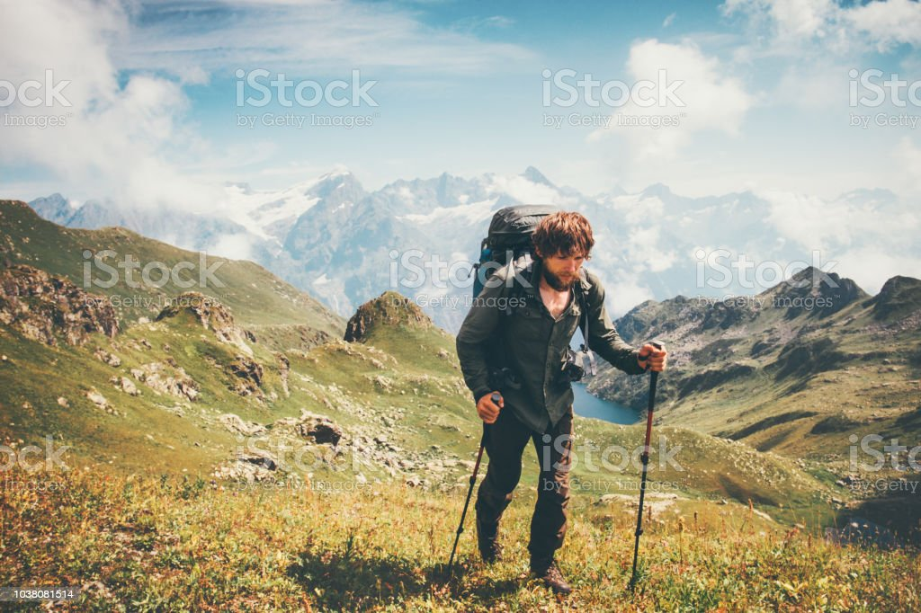 95dfdf1e2ffa Man mountaineering with backpack Traveling Lifestyle concept adventure  summer vacations outdoor mountains range on background hiking climbing  sport - Stock ...