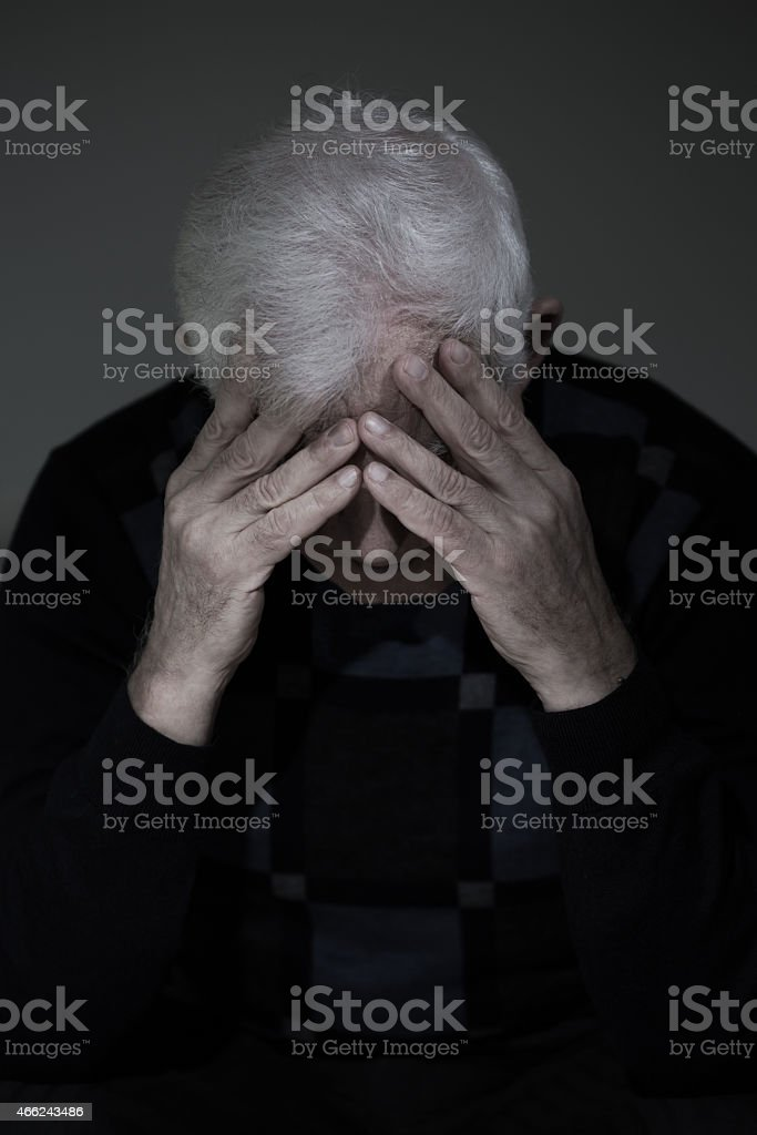 Man mourning his lost love stock photo