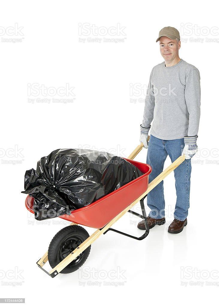Man Moving a Wheelbarrow royalty-free stock photo