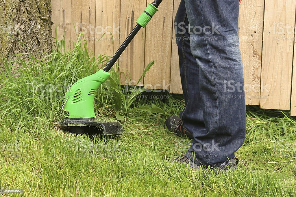 Man mowing the grass, stock photo