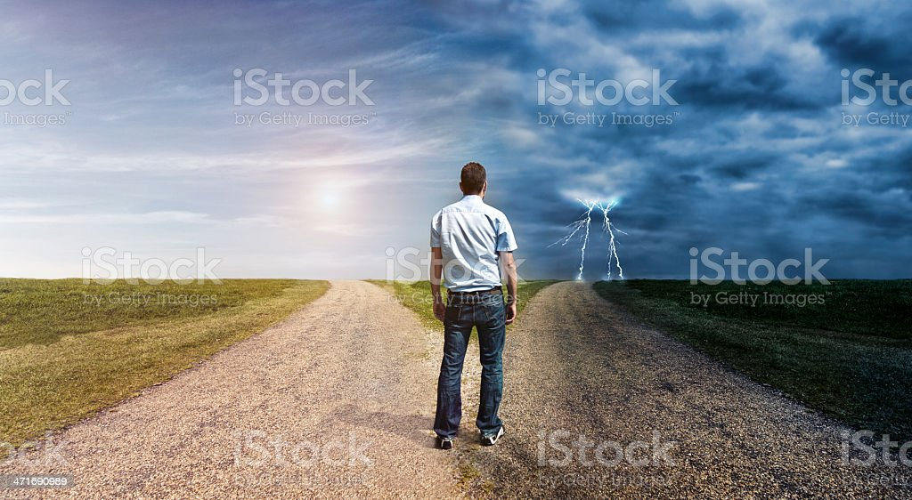 Man must decide his way forward to success or failure stock photo
