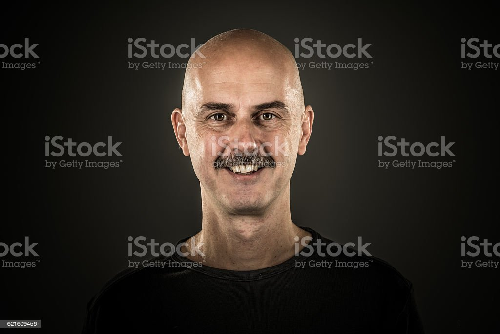 Shaved completely bald