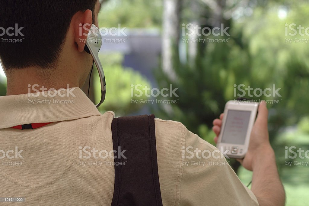 Man navigates with help of GPS and mobile phone royalty-free stock photo