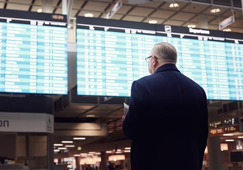 Man near airline schedule