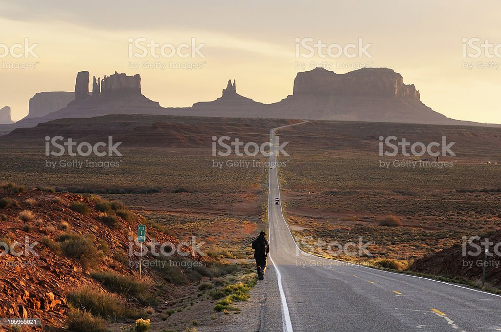 Man near the road in Monument Valley sunset landscape royalty-free stock photo