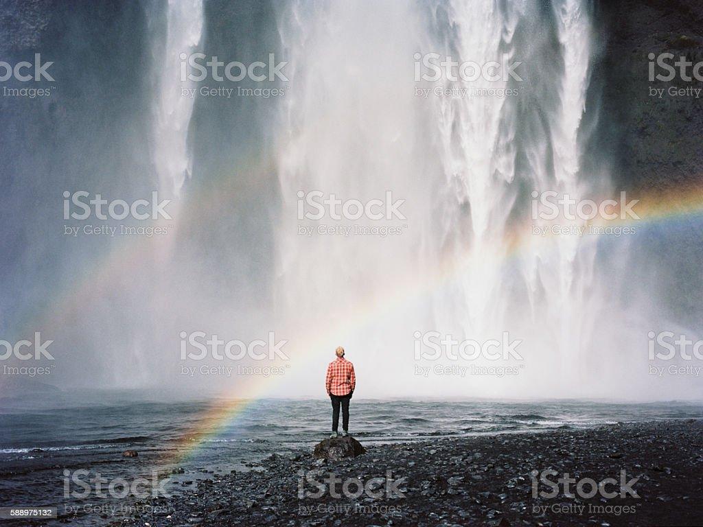 Man near the waterfall stock photo