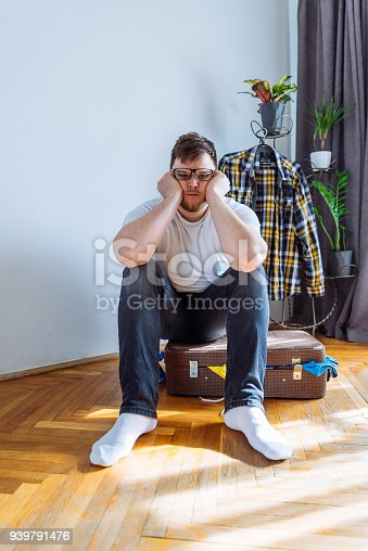 1067846662 istock photo man need help to close suitcase. overloaded bag with clothes. travel concept 939791476