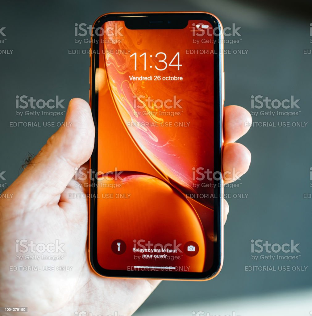 Man New Apple Iphone Xr Red Square Image Stock Photo Download Image Now Istock