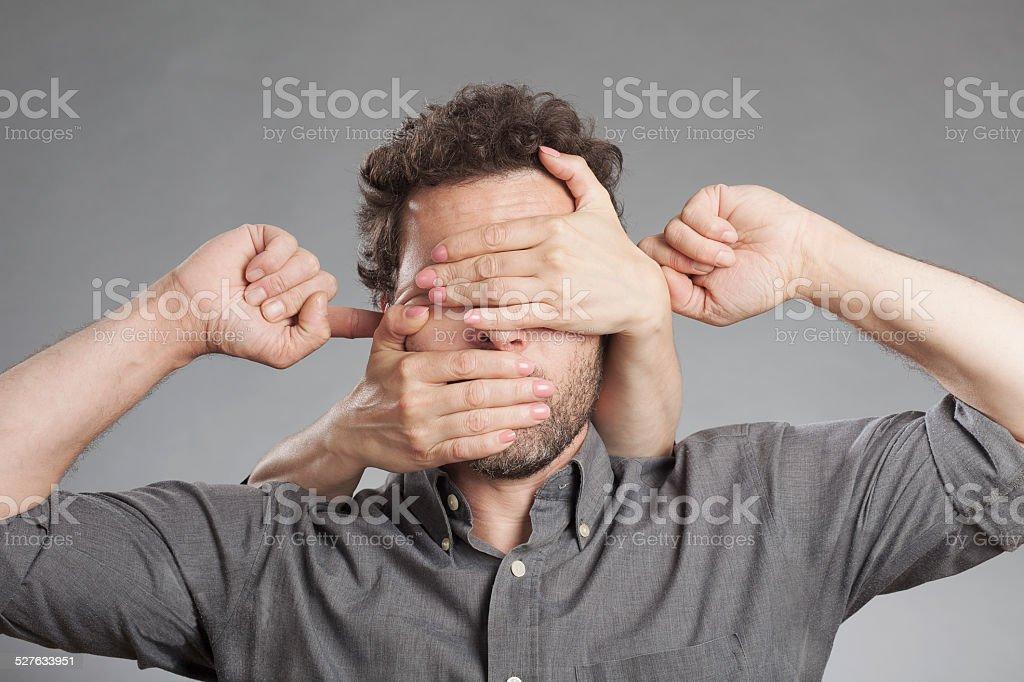 Man not seeing not hearing not saying anything stock photo