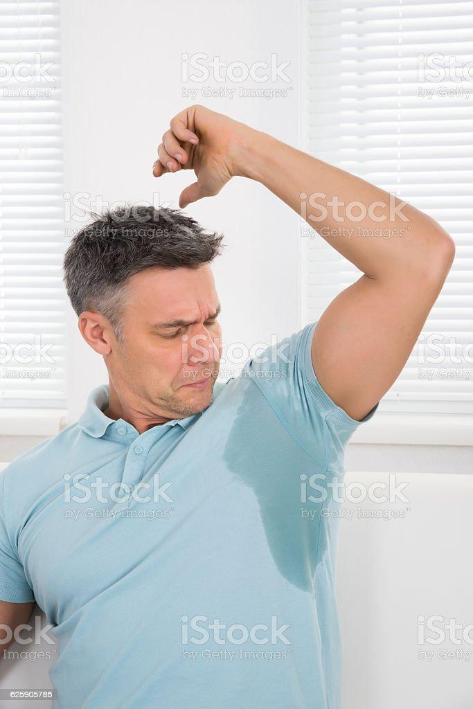 Man Notices His Sweat stock photo