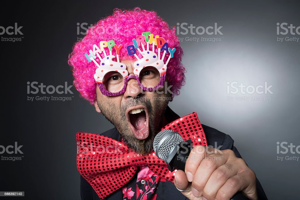 Man of Afro singing the birthday song stock photo