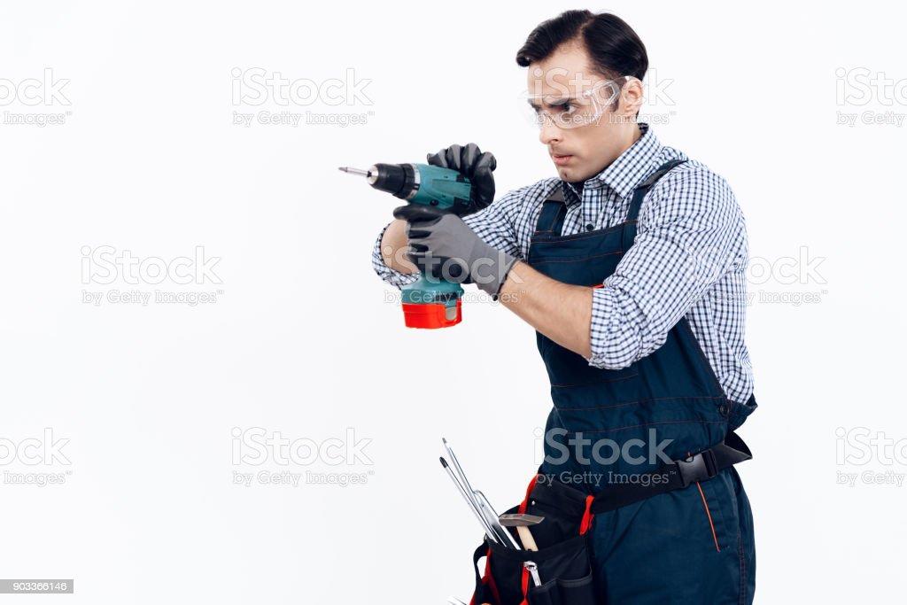 A man of Arab appearance works as a repairman. Handyman posing on...