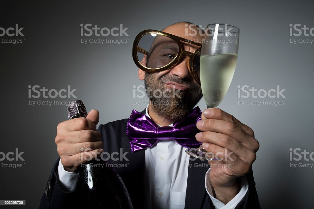 Man of sunglasses stare a champagne glass. stock photo