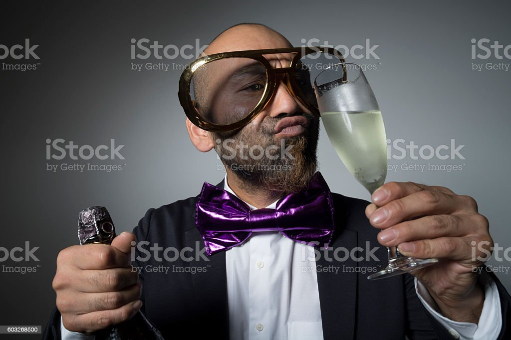 Man of sunglasses to be to drink a champagne glass. stock photo