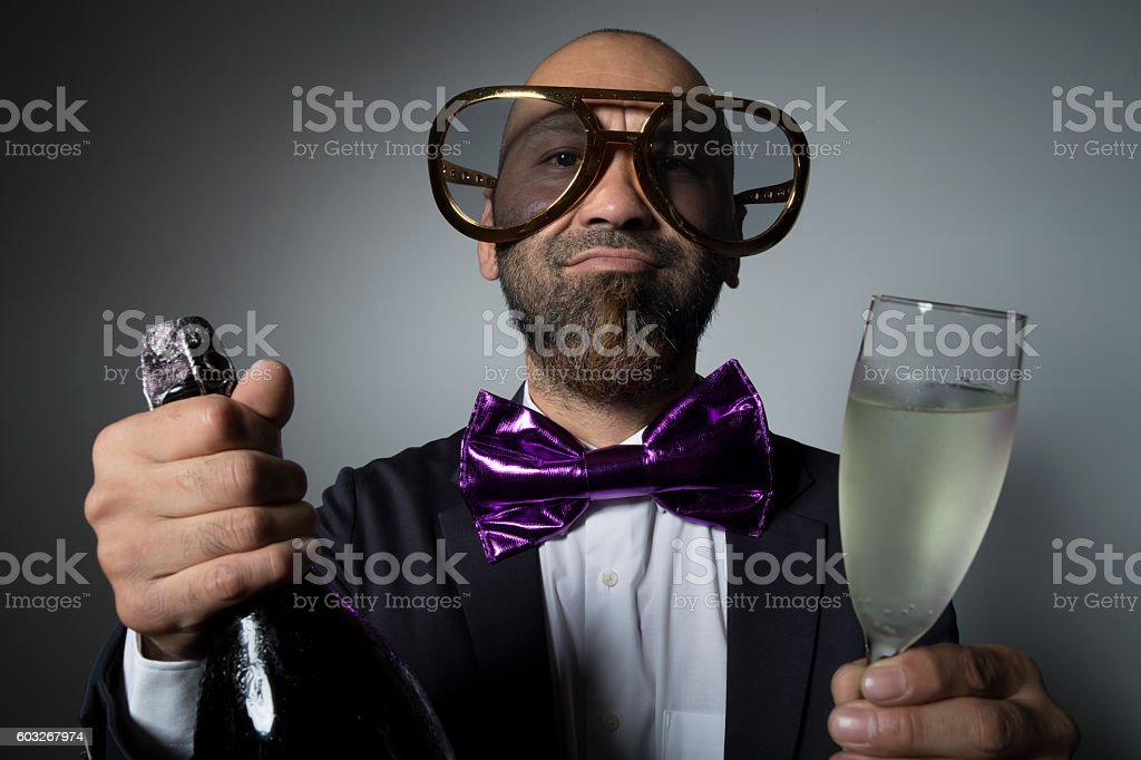 Man of sunglasses with champagne. stock photo