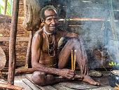 istock Man of the Nomadic Forest Tribe Korowai 1079174990