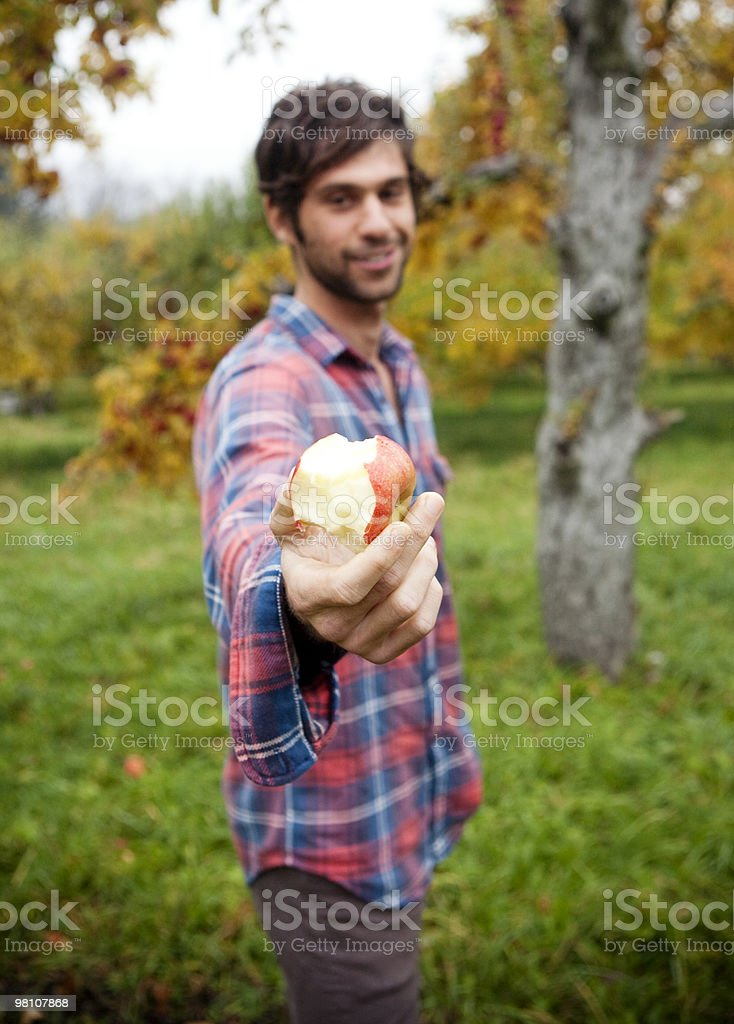 Man offering apple to camera. royalty-free 스톡 사진