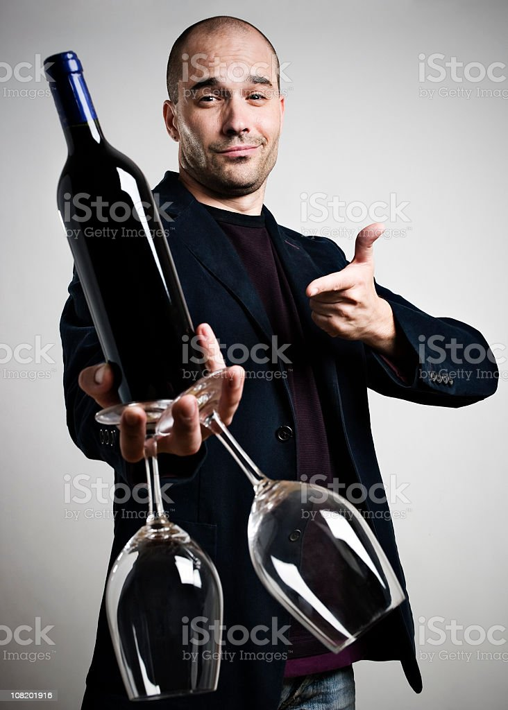 Man Offering Glass of Wine royalty-free stock photo