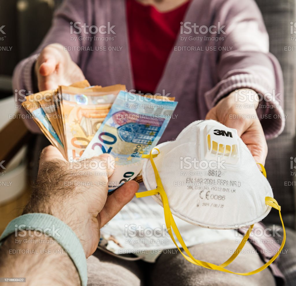 Man offering stack of money banknotes for surgical 3M Hand Sanding Respirator - Royalty-free Adult Stock Photo