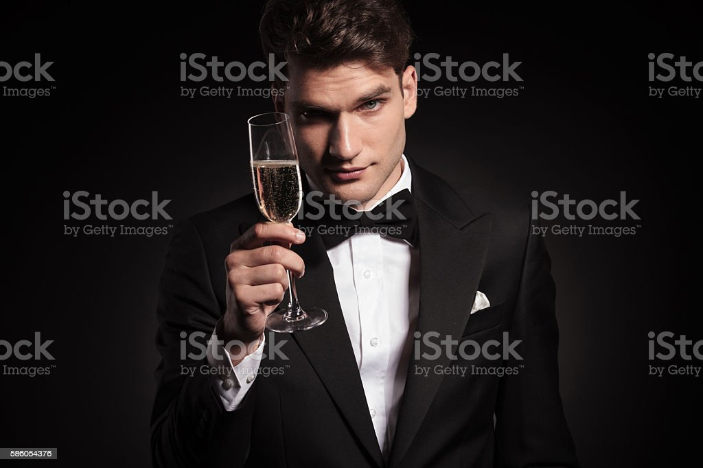 man offering you a glass of champagne. stock photo