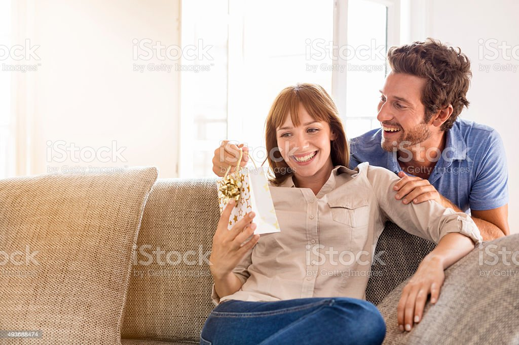 Man offers a Surprise Gift, to his grilfriend royalty-free stock photo