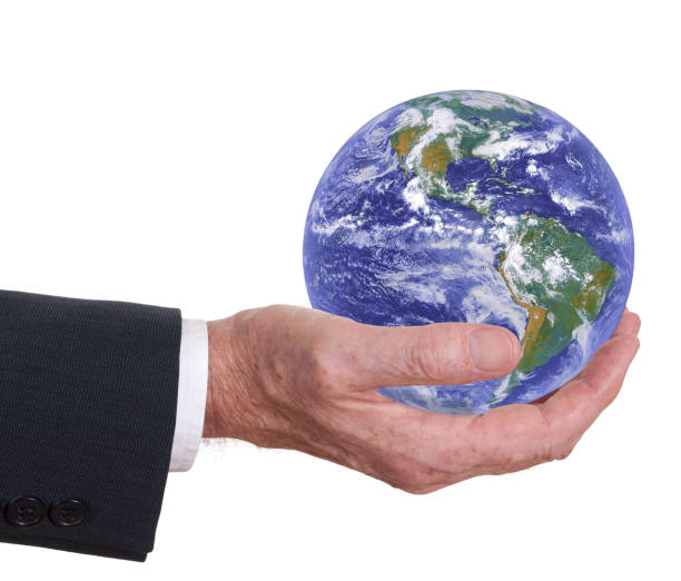Man offers the world, the earth. Americas prominent. Corporate responsibility. Environmental concept. stock photo
