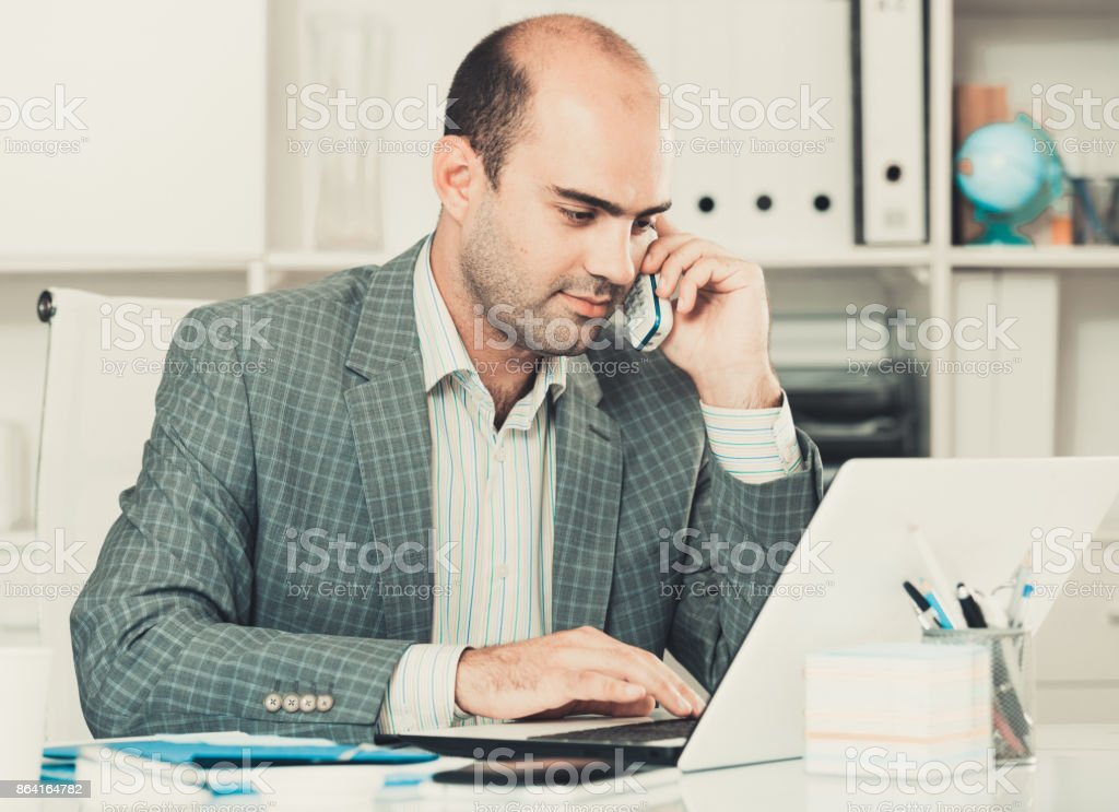 man office worker deciding and talking on the phone royalty-free stock photo