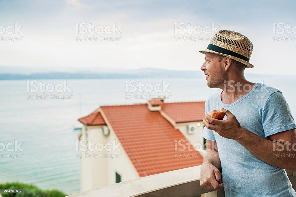 Man on a balcony at hotel in Croatia stock photo