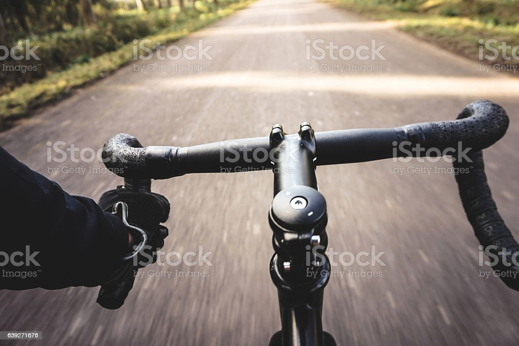 man on a bike pov stock photo