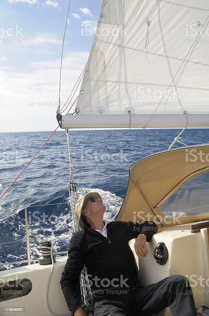 Man on a boat looking at the sails royalty-free stock photo