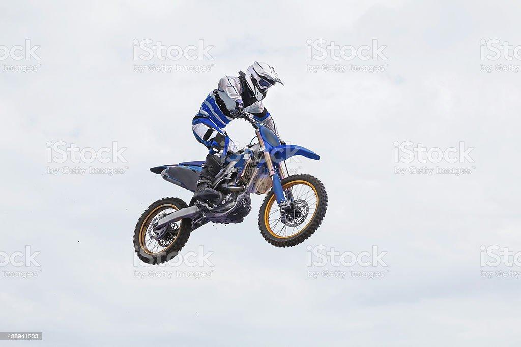 Mid air shot of man riding a dirt bike. RM