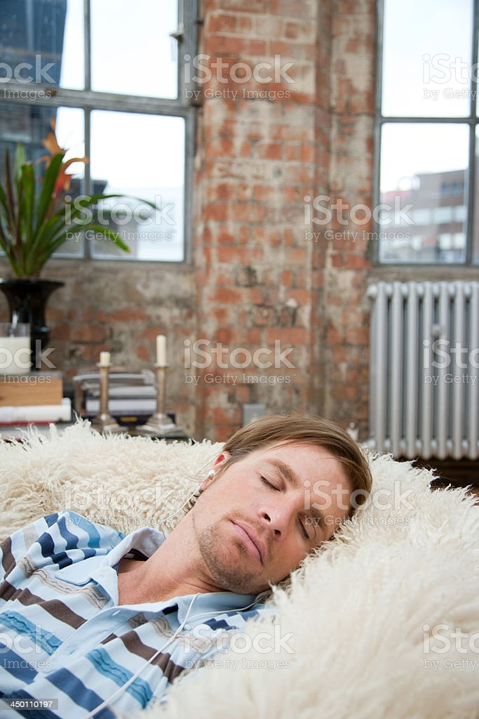 Swell Man On A Furry Bean Bag Chair Wearing Earbuds Stock Photo Forskolin Free Trial Chair Design Images Forskolin Free Trialorg