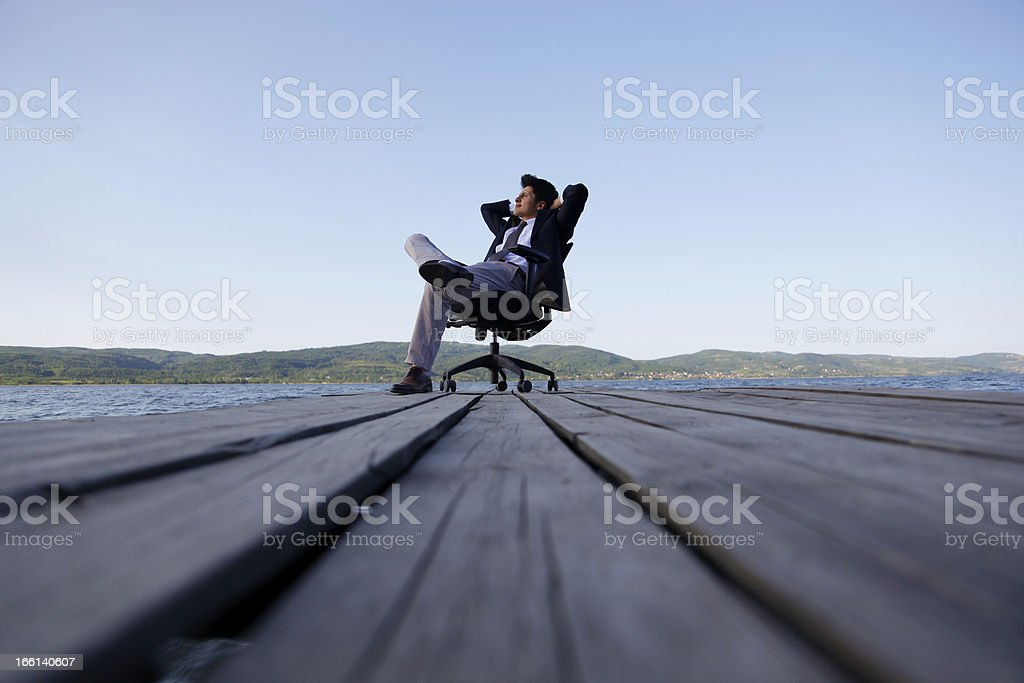 Man on a jetty thinking outdoor royalty-free stock photo