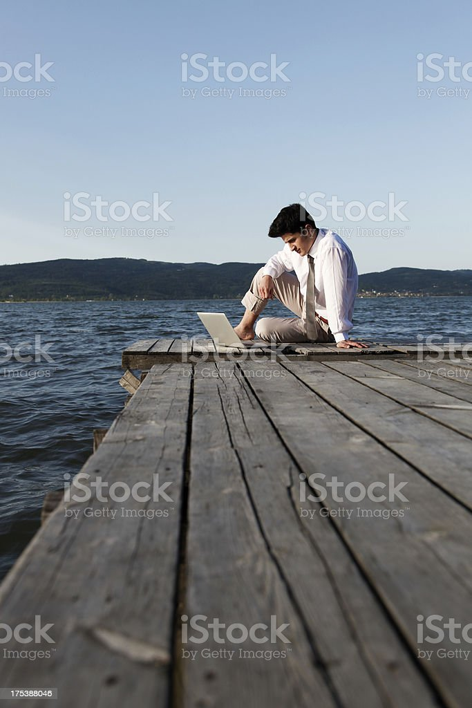 Man on a jetty working outdoor royalty-free stock photo
