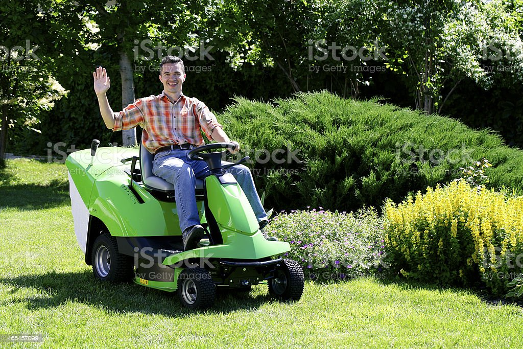 Exhausted Man With Lawn Mower Stock Photo - Image of