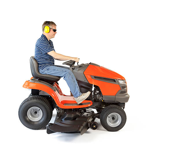 man on a mower - riding lawn mower stock photos and pictures