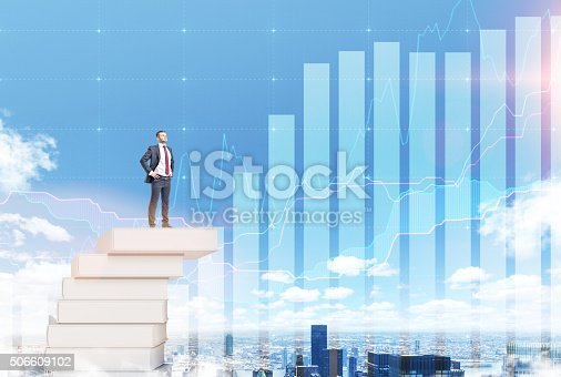istock Man on a pile of books 506609102