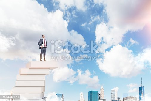 istock Man on a pile of books 506609174
