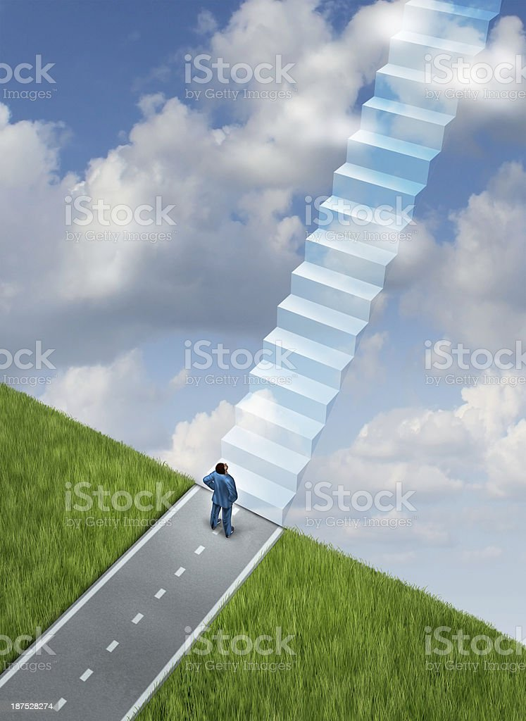 Man on a road looking up at stairs going into the sky stock photo