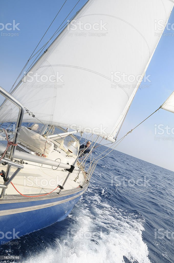 Man on a sailboat royalty-free stock photo