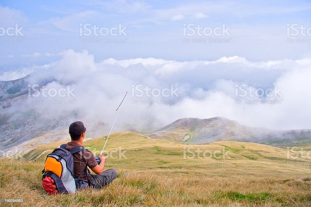 Man on a top of the mountain royalty-free stock photo