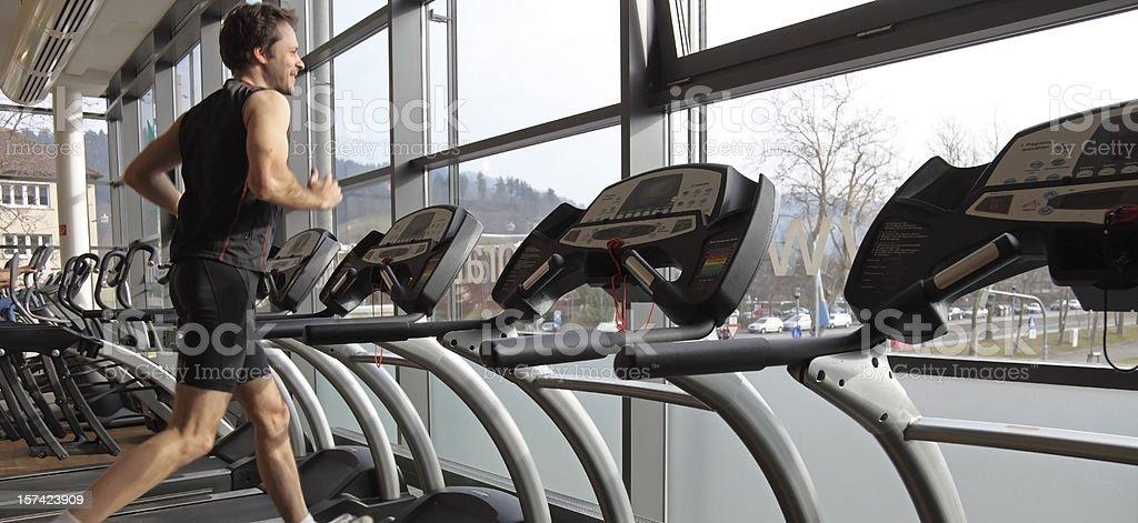 Man on a treadmill stock photo