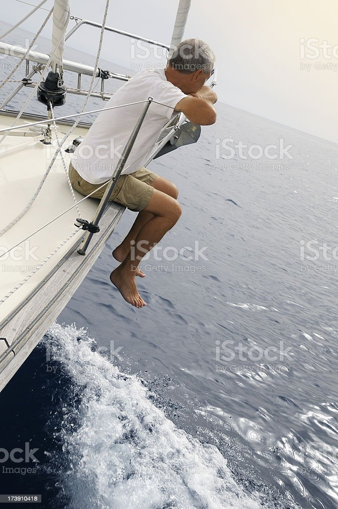 Man on a yacht looking at the horizon royalty-free stock photo
